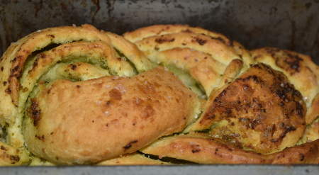 Homemade braided vegan pesto bread, cooked and ready to eat!