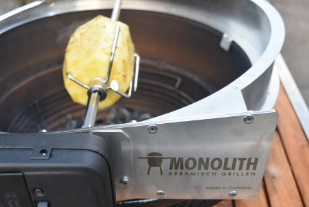 The Monolith's rotisserie attachment is perfect for cooking this boozy pineapple