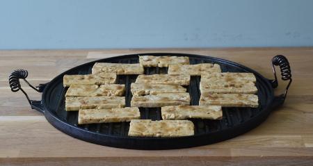 Tofu jerky on the plancha ready to smoke