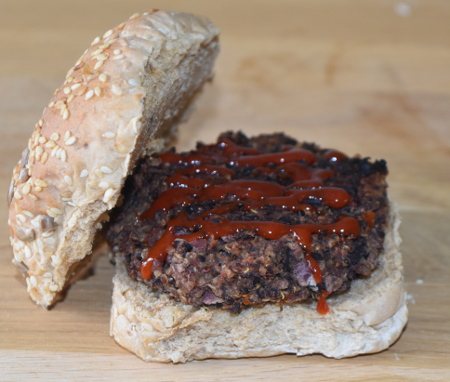 Delicious vegan black bean and quinoa burger with a little drizzle of homemade tomato ketchup!